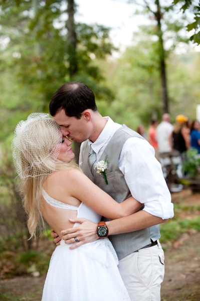 bride and groom embracing