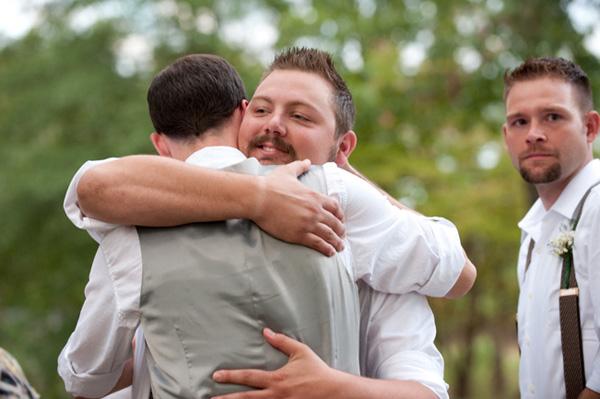 groom hugging groomsmen
