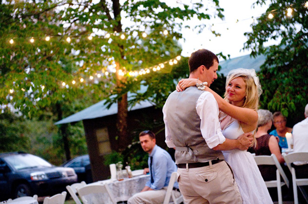 bride and groom dancing under canopy of lights