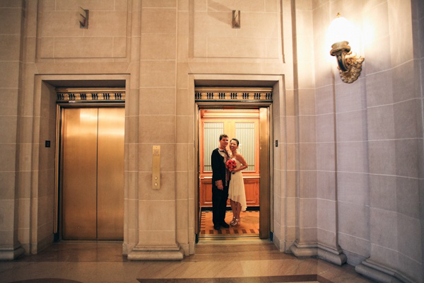 bride and groom in San Francisco courthouse elevator