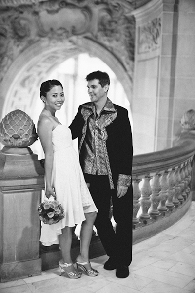 bride and groom inside San Francisco city hall