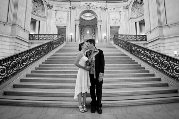 bride and groom kissing at courthouse