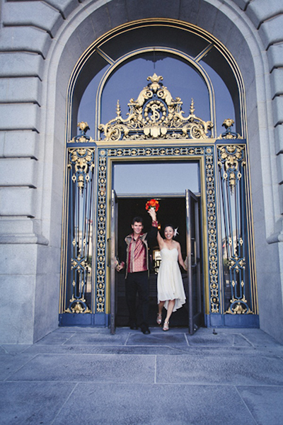 bride and groom exiting San Francisco city hall