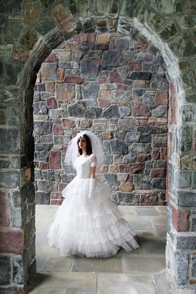 Bride under arbor