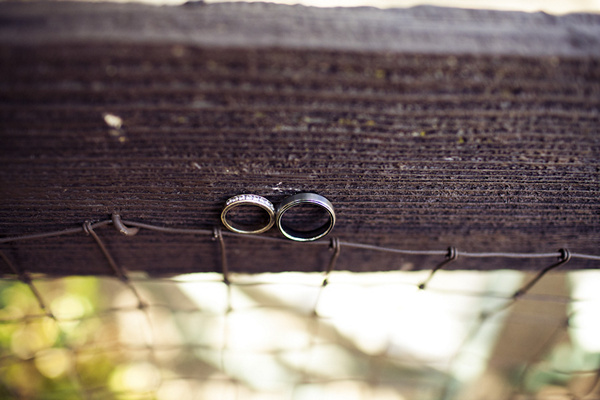 wedding rings on fence