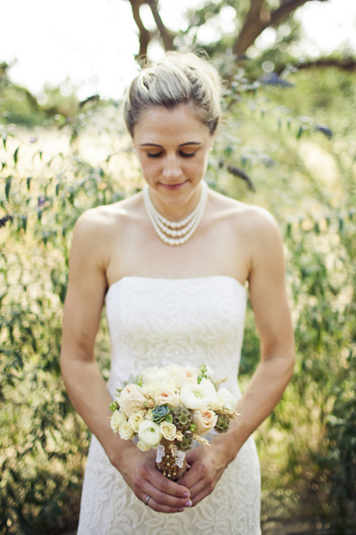 bride with white rose bouquet