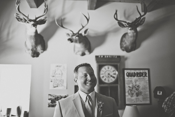 groom portrait with stag heads