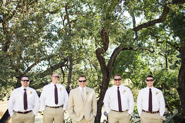 groomsmen in tan slacks and brown ties