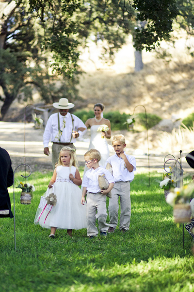 flower girl and ring bearers walking down aisle