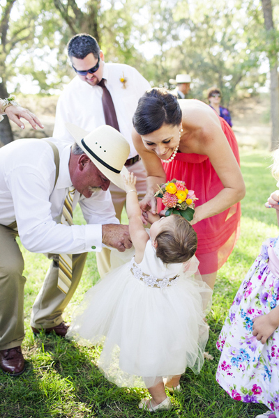flower girl and wedding guests