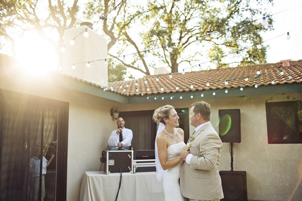 first dance under canopy of string lights