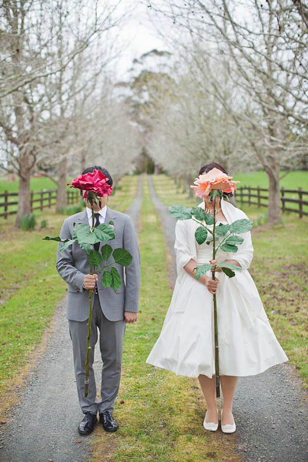 bride and groom with giant roses