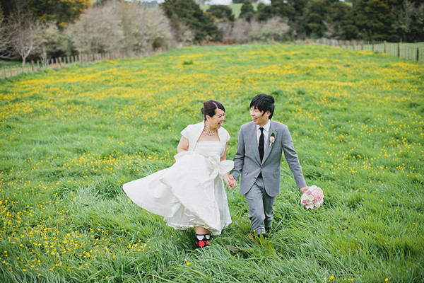 bride and groom in rain boots
