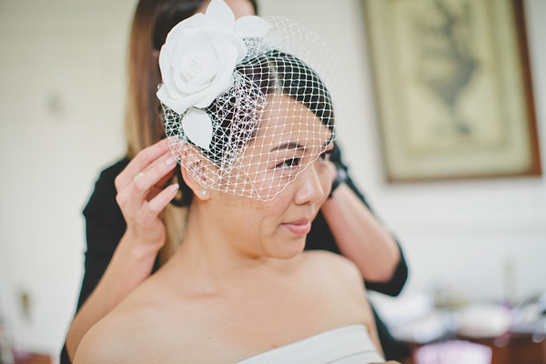 bride in white rose fascinator