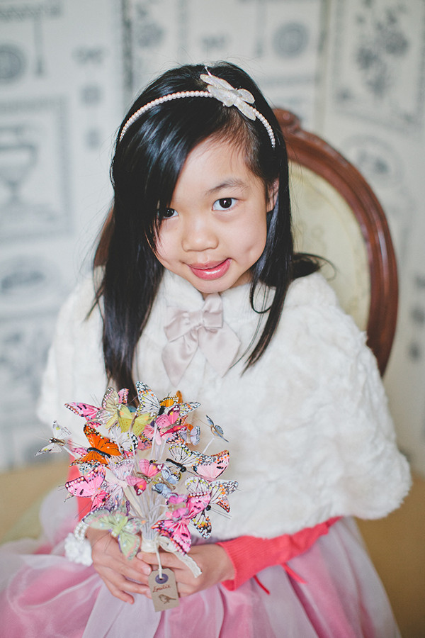 flower girl with butterfly bouquet