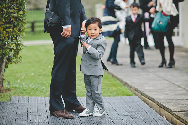 ring bearer in grey suit