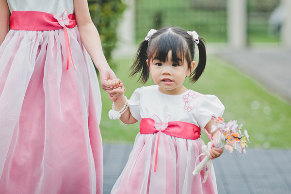 pink flower girls with butterfly bouquet