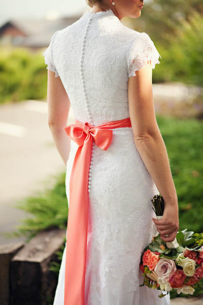 bride in lace dress with pink bow