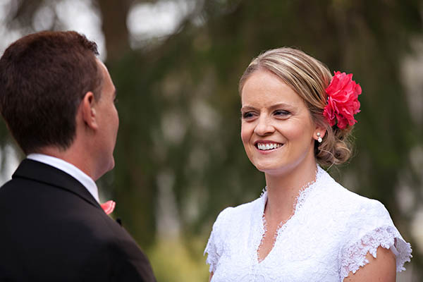bride with pink flower in her hair
