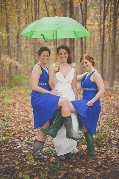 bride under green umbrella