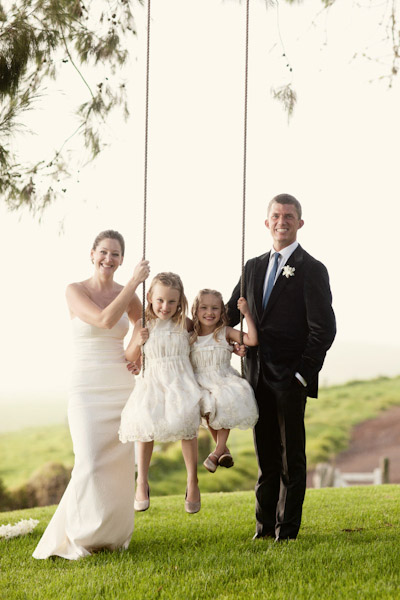 flower girls on tree swing