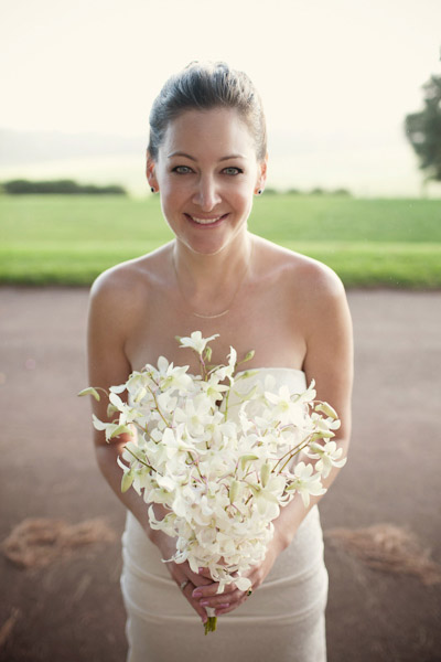 bride with white tropical bouquet