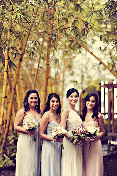bride with bridesmaids in pastel dresses