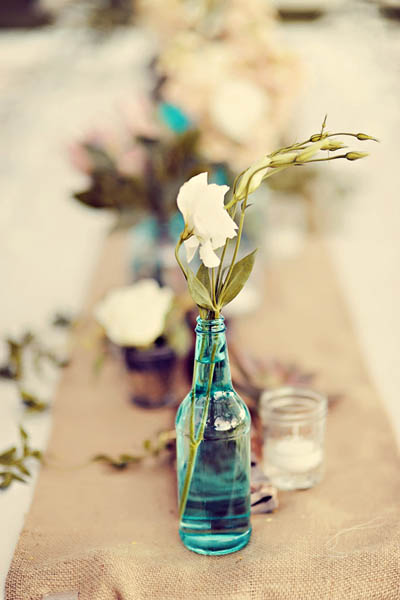 wedding centerpiece in blue bottle