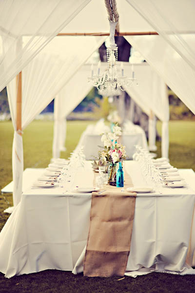 fabric tented reception tables with hanging chandeliers