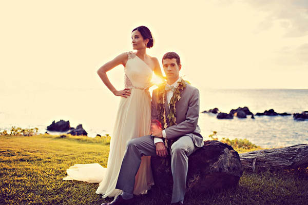bride and groom at sunset in Hawaii