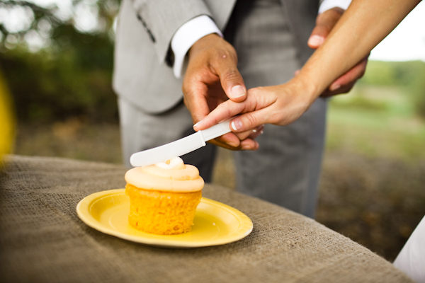 cutting the wedding cupcake