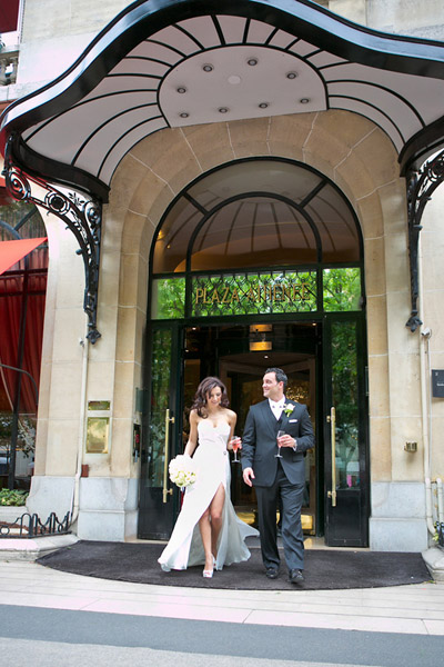 bride and groom in front of paris hotel