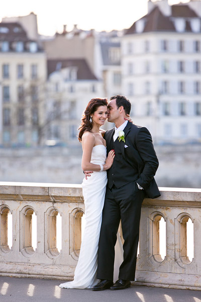 bride and groom on paris bridge