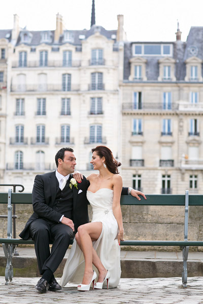 bride and groom on Paris bench