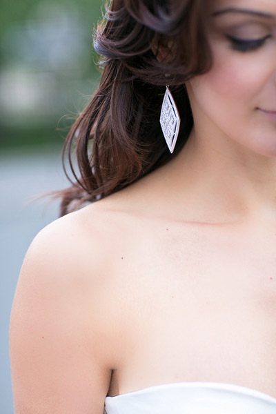 bride wearing statement earrings