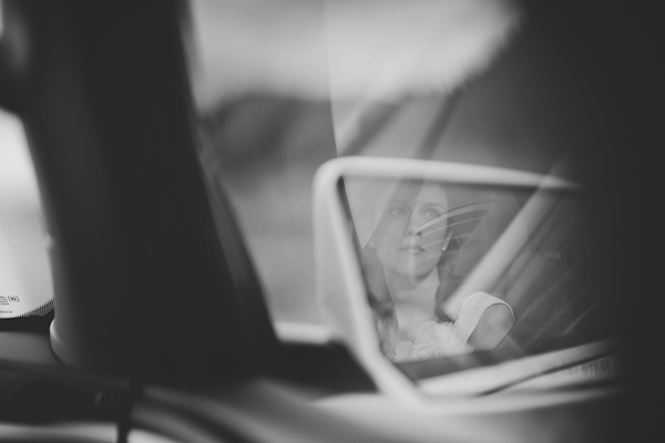 bride reflection in car mirror