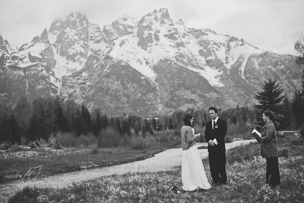 bride and groom eloping by mountains