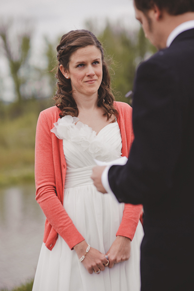 bride wearing pink cardigan