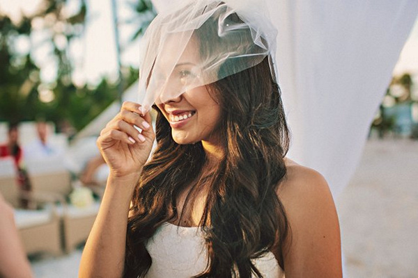 bride pulling down veil