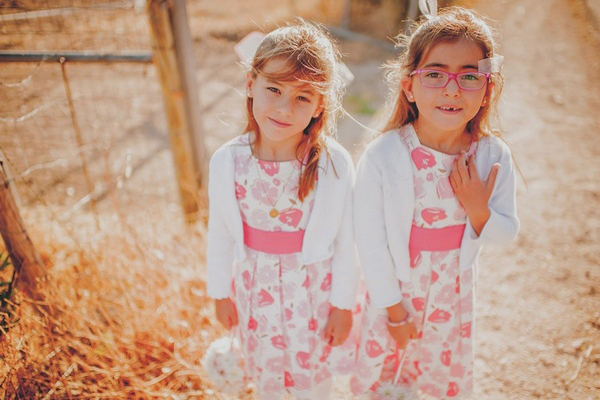 flower girls in pink floral dresses