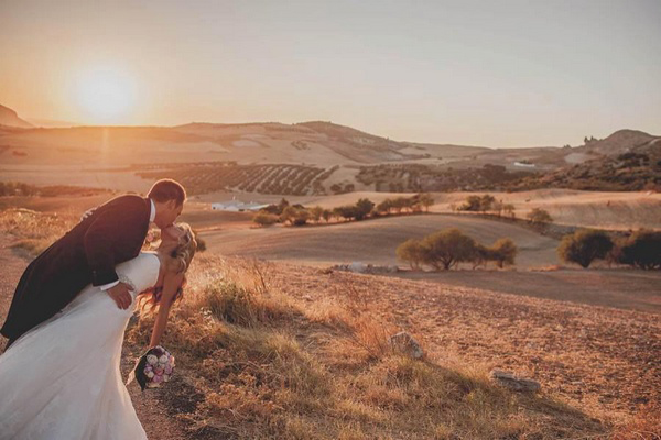 bride and groom kissing in Spanish vineyard
