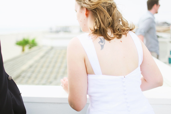 bride with shoulder tattoo