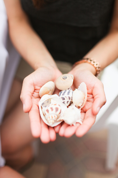wedding guest holding seashells