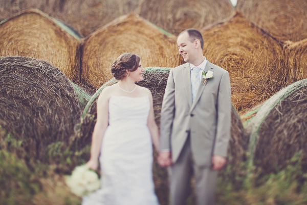 wedding portrait in front of hay bales
