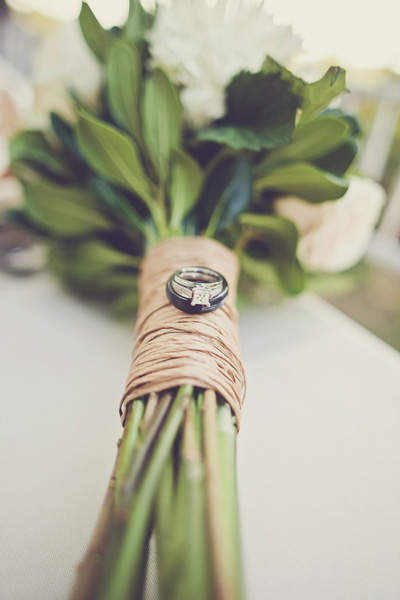 wedding rings on rustic wedding bouquet
