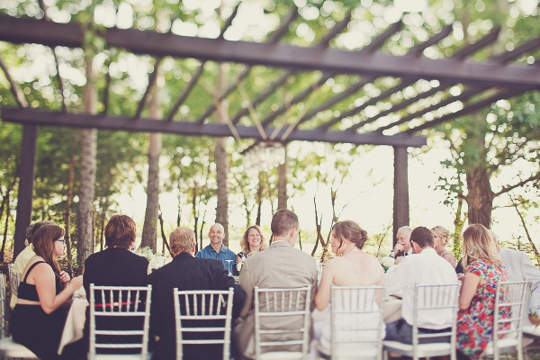 backyard outdoor wedding reception with mason jar chandelier