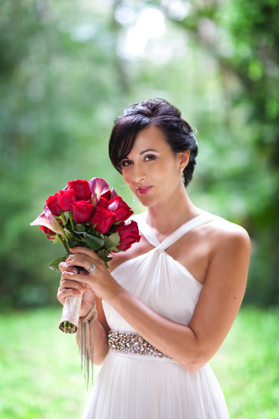 bride with red and pink wedding bouquet
