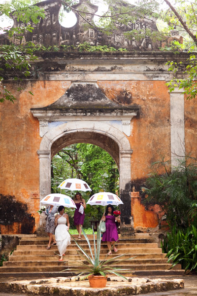 Mexican bride and bridesmaids with umbrellas