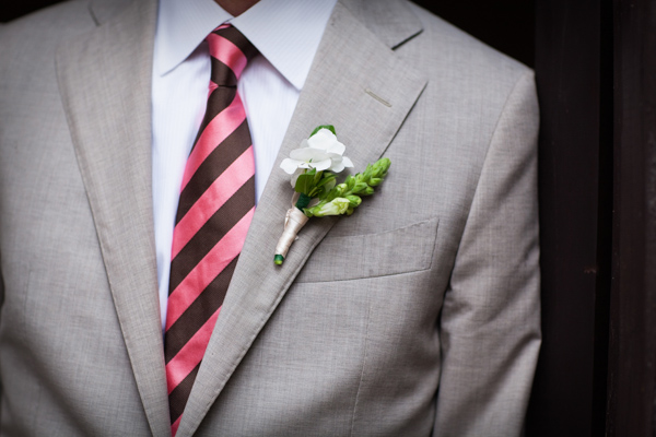 groom with pink and brown striped tie