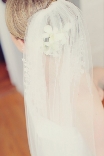 bride with orchids in her hair and veil
